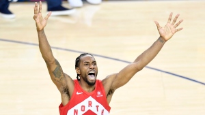 Toronto Raptors' Kawhi Leonard (2) celebrates after the buzzer as the Raptors defeat the Golden State Warriors in Game 6 NBA Finals action to take the NBA Championship in Oakland, Calif., Thursday, June 13, 2019. THE CANADIAN PRESS/Frank Gunn