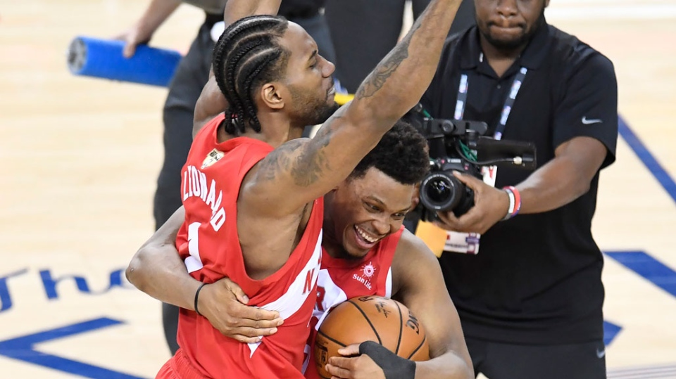 Toronto Raptors forward Kawhi Leonard (2) and Toronto Raptors guard Kyle Lowry (7) celebrate defeating the Golden State Warriors basketball action in Game 6 of the NBA Finals in Oakland, Calif. on Thursday, June 13, 2019. Raptors have won their first NBA title in franchise history. (THE CANADIAN PRESS/Frank Gunn)