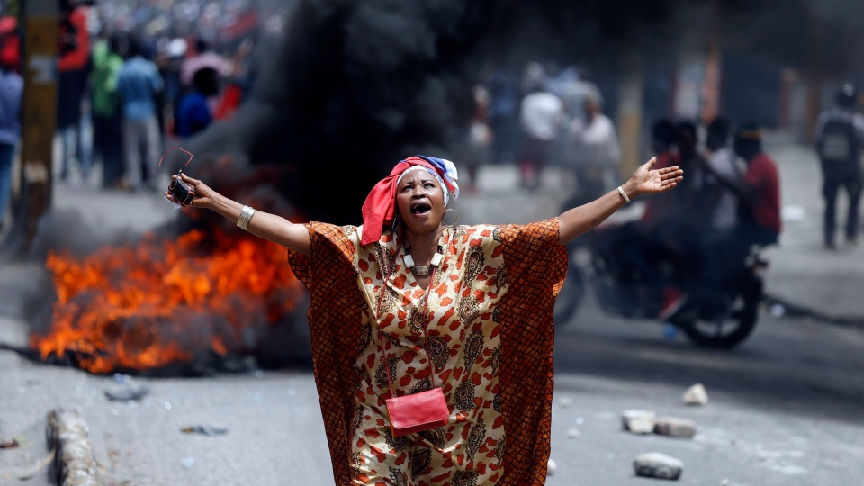 In this June 9, 2019 photo, a protester yells anti-government slogans in Port-au-Prince, Haiti. (AP Photo/Dieu Nalio Chery)