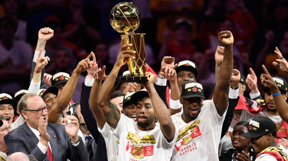 Toronto Raptors forward Kawhi Leonard, centre, holds Larry O'Brien NBA Championship Trophy after defeating the Golden State Warriors basketball action in Game 6 of the NBA Finals in Oakland, Calif. on Thursday, June 13, 2019. Raptors have won their first NBA title in franchise history. (THE CANADIAN PRESS/Frank Gunn)