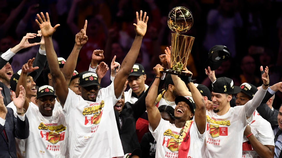 Toronto Raptors guard Kyle Lowry, centre left, holds Larry O'Brien NBA Championship Trophy after defeating the Golden State Warriors basketball action in Game 6 of the NBA Finals in Oakland, Calif. on Thursday, June 13, 2019. THE CANADIAN PRESS/Frank Gunn