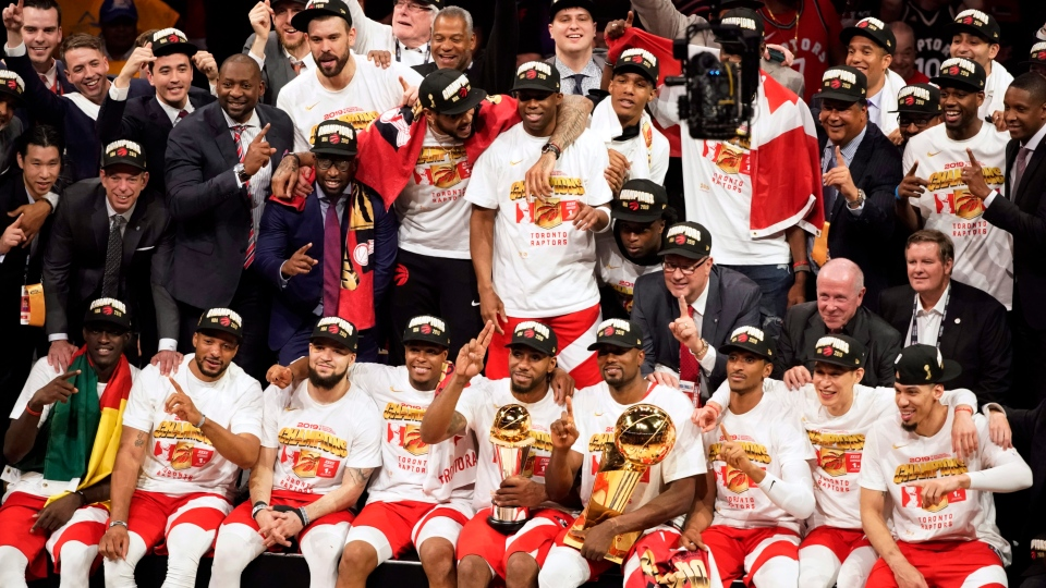 Toronto Raptors players and coaches celebrate after the Raptors defeated the Golden State Warriors in Game 6 of basketball's NBA Finals in Oakland, Calif., Thursday, June 13, 2019. (AP Photo/Tony Avelar)