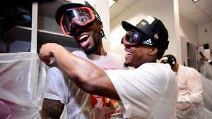 Toronto Raptors forward Kawhi Leonard, left, and teammateKyle Lowry celebrate defeating the Golden State Warriors and winning the Larry O'Brien NBA Championship Trophy after Game 6 basketball action in Oakland, Calif. on Thursday, June 13, 2019. THE CANADIAN PRESS/Frank Gunn