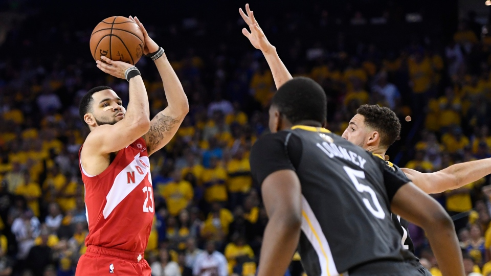 Toronto Raptors guard Fred VanVleet (23) shoots while under pressure from Golden State Warriors centre Kevon Looney (5) and guard Klay Thompson (11) during second half basketball action in Game 6 of the NBA Finals in Oakland, Calif. on Thursday, June 13, 2019. THE CANADIAN PRESS/Frank Gunn