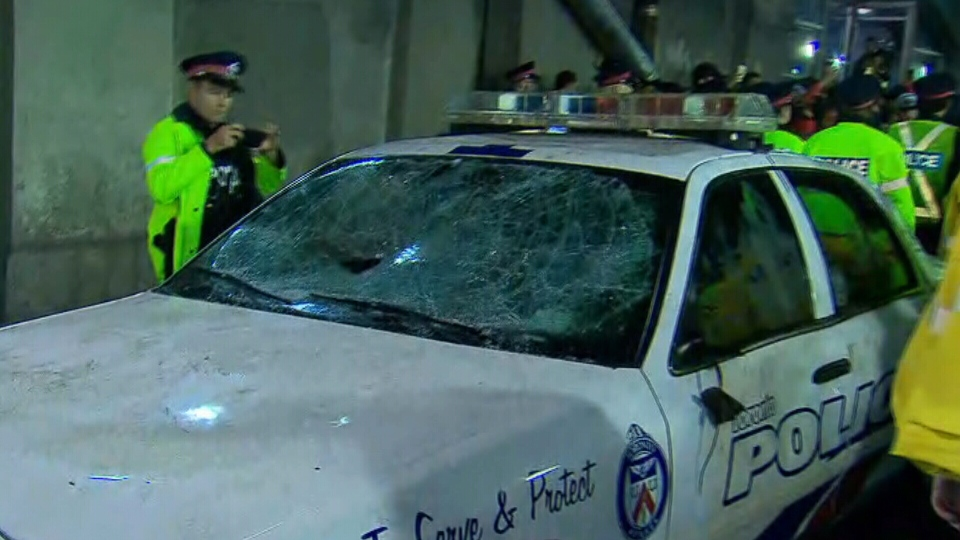 A police car with its windshield smashed on York St. after the Toronto Raptors won the NBA Championship.