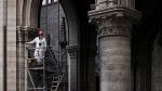 In this May 15, 2019 file photo, a worker stands on scaffolding during preliminary work inside the Notre Dame de Paris Cathedral, in Paris. (Philippe Lopez/Pool via AP, File)