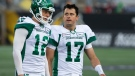Saskatchewan Roughriders quarterback Zach Collaros looks toward Hamilton Tiger-Cats players as he leaves the field with an injury following a late hit during first half CFL football game action in Hamilton, Ont. on Thursday, June 13, 2019. THE CANADIAN PRESS/Peter Power