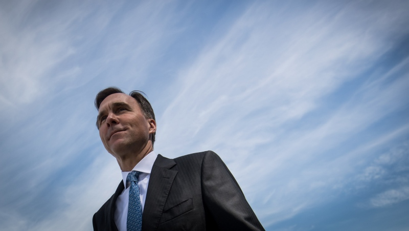 Federal Minister of Finance Bill Morneau arrives for a news conference in Vancouver on June 13, 2019. THE CANADIAN PRESS/Darryl Dyck