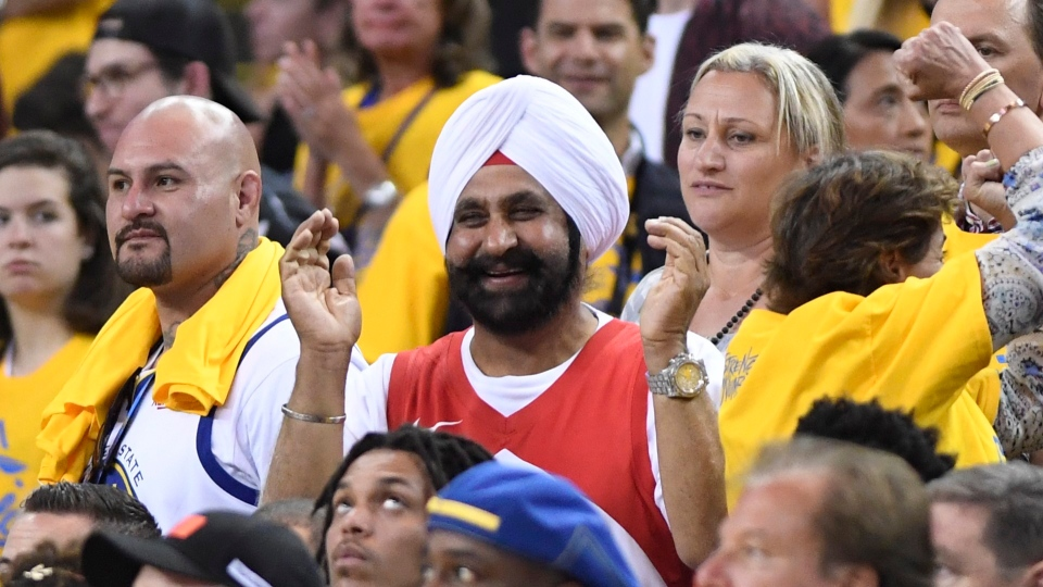 Nav Bhatia, centre, watches the Raptors play Golden State Warriors in Game 4 of the NBA Finals in Oakland, California on Friday, June 7, 2019. (THE CANADIAN PRESS/Frank Gunn)
