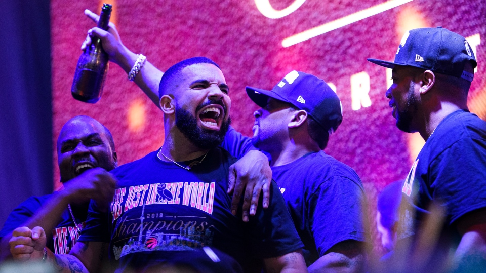 """Toronto-born performer Aubrey """"Drake"""" Graham reacts on stage in Jurassic Park as the Toronto Raptors defeat the Golden State Warriors in Game 6 NBA Finals to win the NBA Championship, in Toronto on Thursday, June 13, 2019. (THE CANADIAN PRESS/Nathan Denette)"""