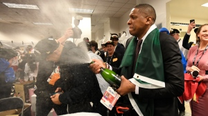 Toronto Raptors President Masai Ujiri celebrates defeating the Golden State Warriors and winning the Larry O'Brien NBA Championship Trophy after Game 6 basketball action in Oakland, Calif. on Thursday, June 13, 2019. Raptors have won their first NBA title in franchise history. THE CANADIAN PRESS/Frank Gunn
