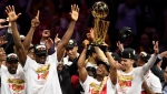 Toronto Raptors guard Kyle Lowry, centre left, holds Larry O'Brien NBA Championship Trophy after defeating the Golden State Warriors basketball action in Game 6 of the NBA Finals in Oakland, Calif. on Thursday, June 13, 2019. (THE CANADIAN PRESS/Frank Gunn)