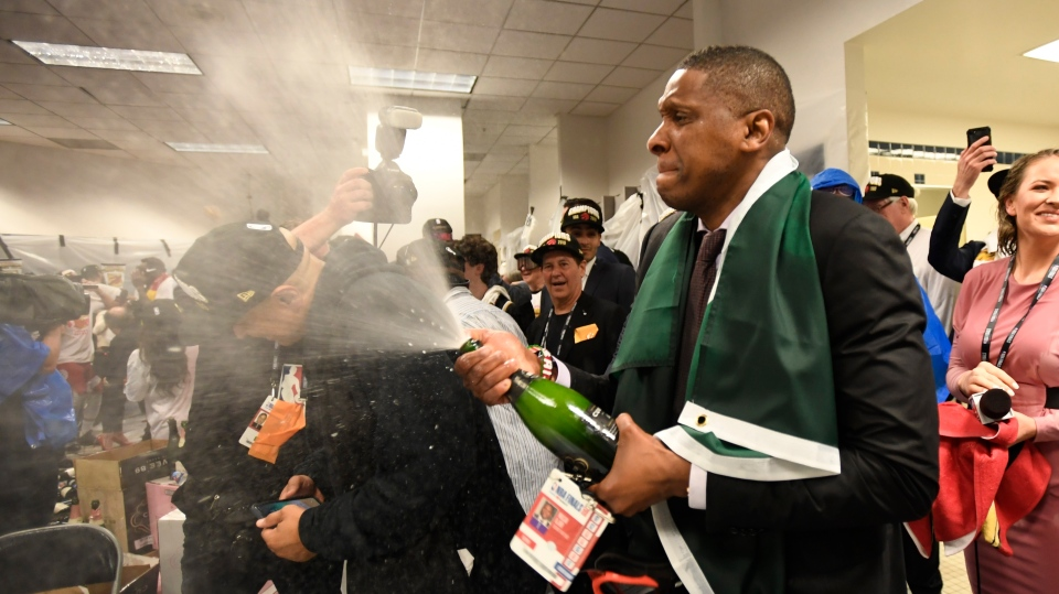 Toronto Raptors President Masai Ujiri celebrates defeating the Golden State Warriors and winning the Larry O'Brien NBA Championship Trophy after Game 6 basketball action in Oakland, Calif. on Thursday, June 13, 2019. Raptors have won their first NBA title in franchise history. (THE CANADIAN PRESS/Frank Gunn)