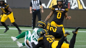 Saskatchewan Roughriders quarterback Zach Collar is hit late by Hamilton Tiger-Cats' Simoni Lawrence after Collaros was downed by Tiger-Cats' Julian Howsare during first half CFL football game action in Hamilton on Thursday, June 13, 2019. Collaros was injured in the first quarter of their game Thursday night versus the Hamilton Tiger-Cats. THE CANADIAN PRESS/Peter Power