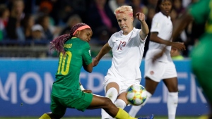 Canada's Sophie Schmidt kicks the ball past Cameroon's Jeannette Yango, left, during the Women's World Cup Group E soccer match between Canada and Cameroon in Montpellier, France, Monday, June 10, 2019. (AP Photo/Claude Paris)