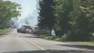 This photo taken from video appears to show smoke billowing from the school bus as it attempts to drive out of the ditch. (Submitted)