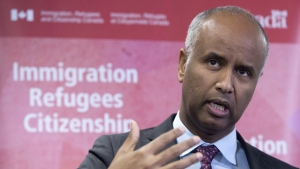"In this file photo, Minister of Immigration Ahmed Hussen makes an announcement of support for pre-arrival services at the YMCA in Toronto on January 14, 2019. Hussen announced the communities chosen for the ""rural and northern immigration pilot"" -- a program that will give rural employers the ability to directly select immigrants to hire in their businesses. THE CANADIAN PRESS/Frank Gunn"