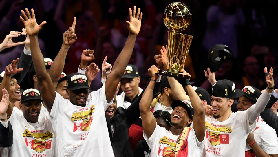Toronto Raptors guard Kyle Lowry, centre left, holds Larry O'Brien NBA Championship Trophy after defeating the Golden State Warriors basketball action in Game 6 of the NBA Finals in Oakland, Calif. on Thursday, June 13, 2019. Raptors have won their first NBA title in franchise history. (THE CANADIAN PRESS/Frank Gunn)