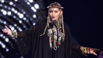In this Aug. 20, 2018 file photo, Madonna presents a tribute to Aretha Franklin at the MTV Video Music Awards at Radio City Music Hall in New York. (Photo by Chris Pizzello/Invision/AP, File)
