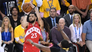 Toronto Raptors guard Fred VanVleet (23) fires a shot as Golden State Warriors centre Kevon Looney (5) defends during first half basketball action in Game 6 of the NBA Finals in Oakland, Calif. on Thursday, June 13, 2019. THE CANADIAN PRESS/Frank Gunn