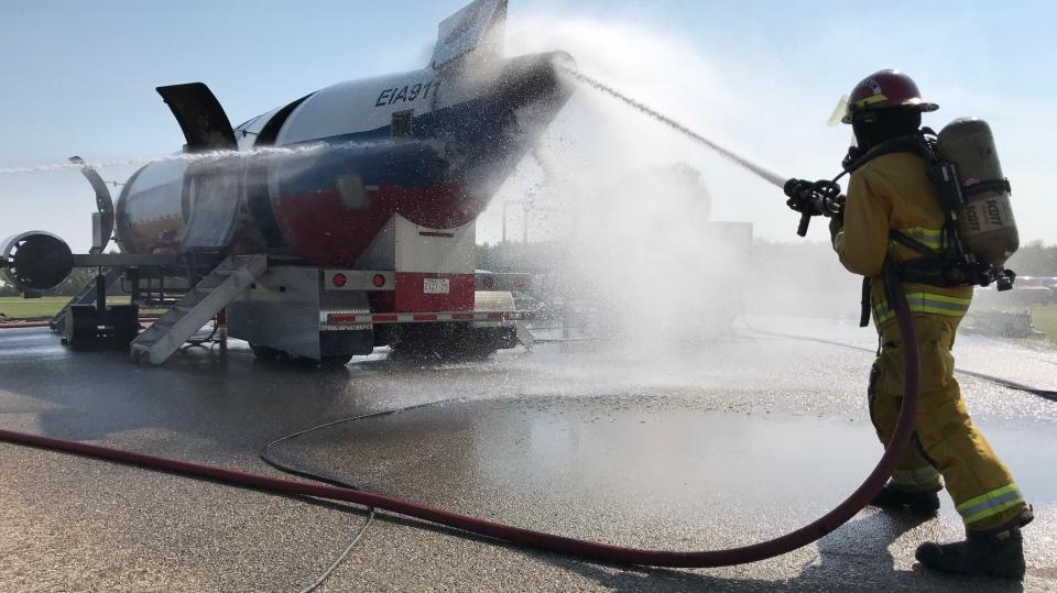 A firefighter is pictured at a plane crash simulation in Edmonton on June 14, 2019. (Chris Brinkworth / CTV News Edmonton)