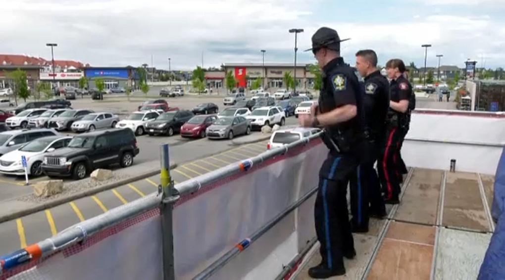 Cops, campout, Walmart, roof, Calgary