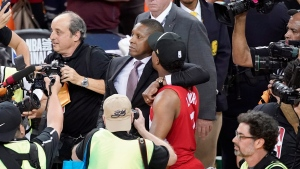 Toronto Raptors general manager Masai Ujiri, centre left, walks with guard Kyle Lowry after the Raptors defeated the Golden State Warriors in Game 6 of basketball's NBA Finals in Oakland, Calif., Thursday, June 13, 2019. (AP Photo/Tony Avelar)