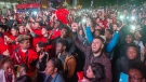 Toronto Raptors fans celebrate after winning the NBA Championship at a viewing party on the streets of downtown Montreal, Thursday, June 13, 2019. THE CANADIAN PRESS/Ryan Remiorz
