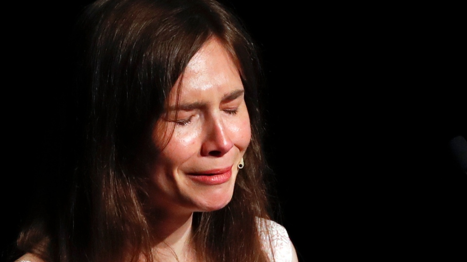 Amanda Knox gets emotional as she speaks at a Criminal Justice Festival at the University of Modena, Italy, Saturday, June 15, 2019. (AP Photo/Antonio Calanni)