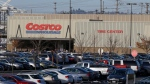 In this Tuesday, Nov. 24, 2015, file photo, cars fill the parking lot of a Costco store. (AP Photo/Ted S. Warren, File)