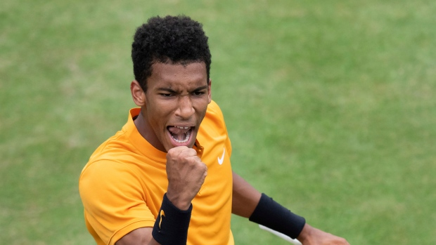 Felix Auger-Aliassime reacts during the quarterfinals of the Stuttgart Open tennis tournament against Dustin Brown of Germany,, Friday, June 14, 2019, in Stuttgart, Germany. Auger-Aliassime won 7-6 (3), 6-7 (2), 7-6 (2). (Silas Stein/dpa via AP)