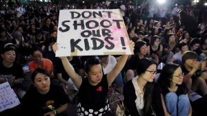 Hundreds of mothers protest against the amendments to the extradition law in Hong Kong on Friday, June 14, 2019. Calm appeared to have returned to Hong Kong after days of protests by students and human rights activists opposed to a bill that would allow suspects to be tried in mainland Chinese courts. (AP Photo/Vincent Yu)