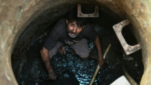Hundreds of thousands of mostly low-caste Indians are employed as 'manual scavengers' who clear underground pipes and septic tanks without any protective gear or masks. (AFP)
