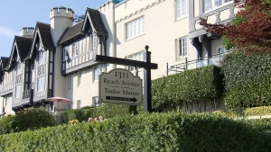The violent burglary happened at Tudor Manor on Beach Avenue near Jervis Street.