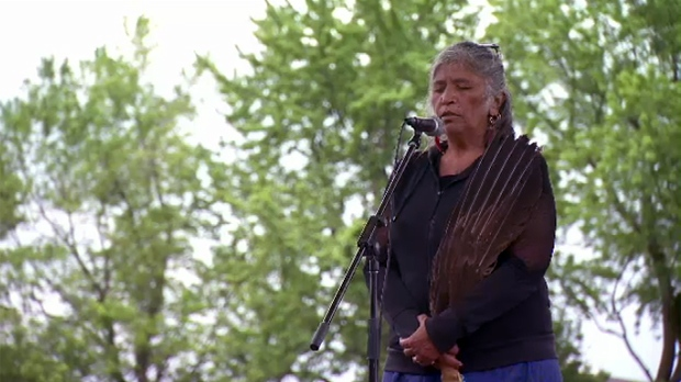 An elder led a prayer before people marched up Mount Royal in the annual Spirit Walk (June 15, 2019)