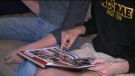 John McRae Secondary School students flip through a yearbook.