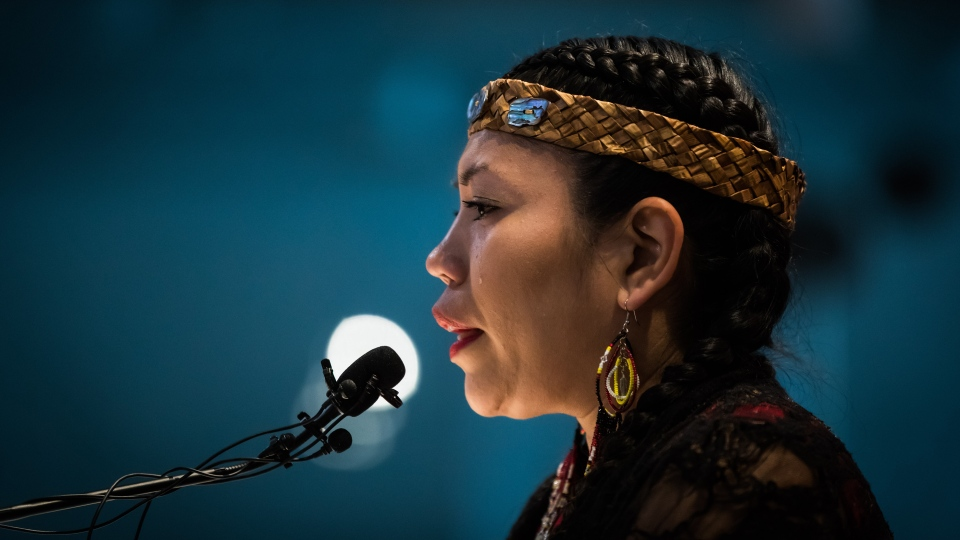 Lorelei Williams, whose cousin Tanya Holyk was murdered by serial killer Robert Pickton and aunt Belinda Williams went missing in 1978, sheds tears while responding to the report on the National Inquiry into Missing and Murdered Indigenous Women and Girls, along with other Indigenous women and allies in Vancouver, on Monday June 3, 2019. (THE CANADIAN PRESS/Darryl Dyck)
