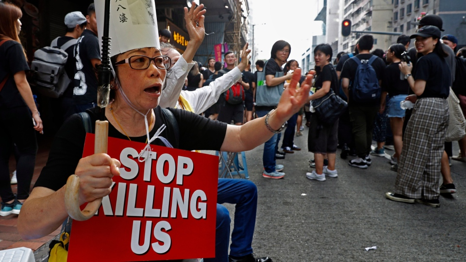 Protesters raise placards as they march on the streets against an extradition bill in Hong Kong on Sunday, June 16, 2019. (AP Photo/Vincent Yu)