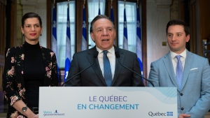 Quebec Premier Francois Legault speaks during a end of session wrap up news conference, Friday, June 14, 2019 at his office in Quebec City. Legault is flanked by Quebec Deputy premier and Public Security Minister Genevieve Guilbault, left, and government House Leader and Minister of Immigration, Diversity and Inclusiveness Simon Jolin-Barrette. THE CANADIAN PRESS/Jacques Boissinot