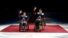 FILE - In this Saturday, Nov. 24, 2018, file photo, Ryan Straschnitzki, left, and Jacob Wassermann, victims of the Humboldt, Saskatchewan bus crash in 2017, are introduced in the first period of an NHL hockey game, in Denver. (AP Photo/David Zalubowski, File)