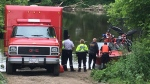 Fire crews are seen here searching for a man that fell into the Grand River. June 16, 2019.
