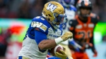 Winnipeg Blue Bombers' Andrew Harris (33) runs the ball against the B.C. Lions during the second half of CFL football action in Vancouver, B.C., on Saturday June 15, 2019. (The Canadian Press/Ben Nelms)