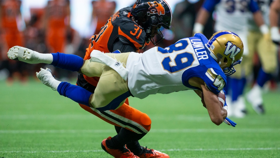 Winnipeg Blue Bombers Kenny Lawler (89) is tackled by B.C. Lions' Odell Willis (11) during the second half of CFL football action in Vancouver, B.C., on Saturday June 15, 2019. (The Canadian Press/Ben Nelm)