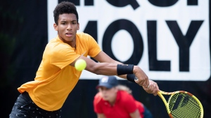 Canada's Felix Auger-Aliassime returns the ball during his final match against Italy's Matteo Berrettini at the ATP Tennis tournament in Stuttgart, Germany, June 16, 2019. (Silas Stein/dpa via AP)