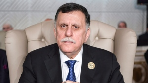 Libyan unity government Prime Minister Fayez al-Sarraj attends the opening of the 30th Arab Summit in Tunis, Tunisia, Sunday, March 31, 2019.  (Fethi Belaid/ Pool photo via AP)
