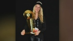 Halifax native Shelby Weaver, pictured with the NBA Championship trophy that she earned as a member of the Toronto Raptors front office staff.