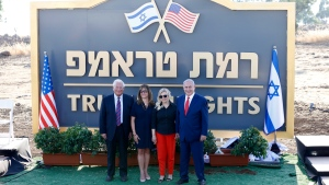 Israeli Prime Minister Benjamin Netanyahu, right, his wife Sara , United States Ambassador to Israel David Friedman, left, his wife Tammy pose during the inauguration of a new settlement named after President Donald Trump in the Golan Heights, Sunday, June 16, 2019. (AP Photo/Ariel Schalit)