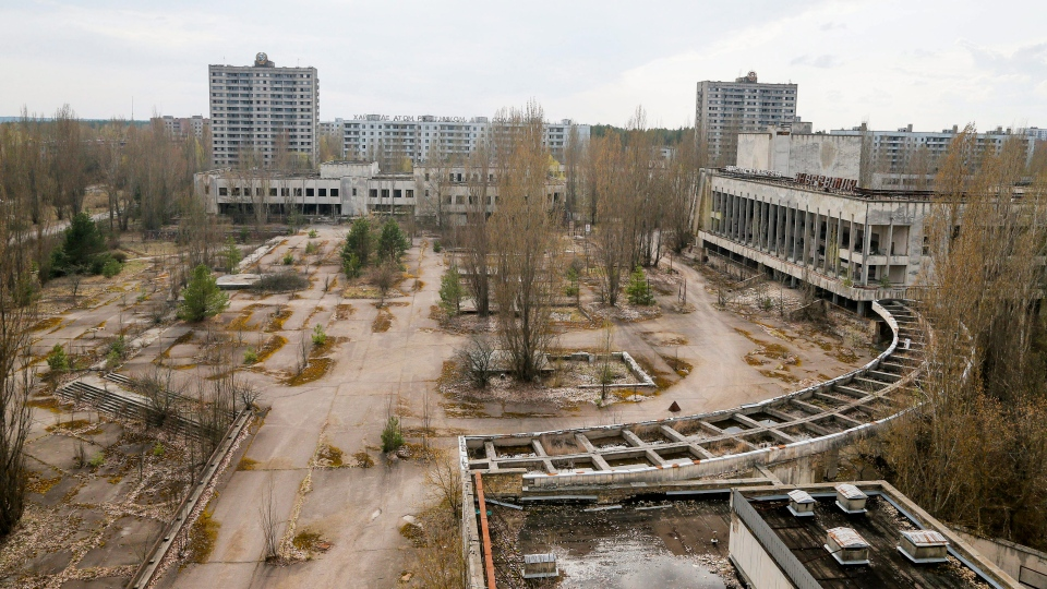 This photo taken Wednesday, April 5, 2017, shows a central square in the deserted town of Pripyat, some 3 kilometers (1.86 miles) from the Chernobyl nuclear power plant in Ukraine. (AP Photo/Efrem Lukatsky)
