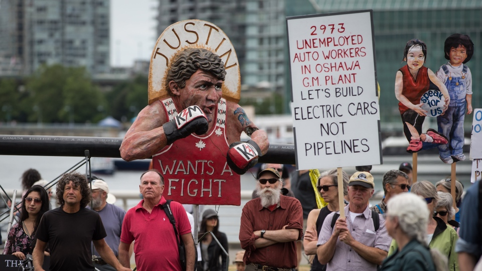 An effigy of Prime Minister Justin Trudeau is seen as protesters opposed to the Trans Mountain pipeline expansion listen during a rally ahead of a decision by Liberal cabinet on the project, in Vancouver, on Sunday June 9, 2019. THE CANADIAN PRESS/Darryl Dyck
