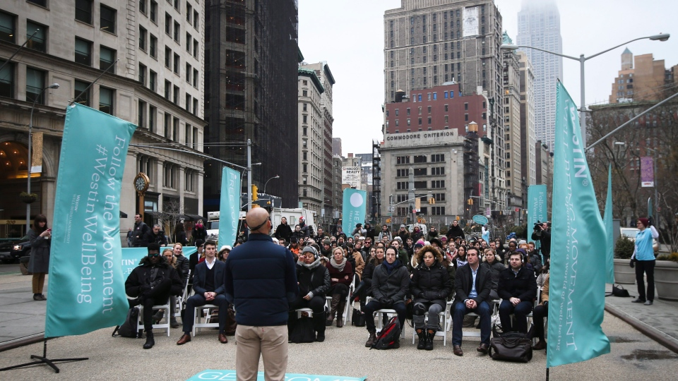 Commuters participate in a Meditation Moment led by Headspace co-founder Andy Puddicombe in celebration of the Westin Well-being Movement launch at Flatiron Plaza, Thursday, March 20, 2014, in New York. (John Minchillo/AP Images for Westin Hotels & Resorts)